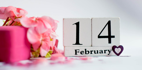 Valentine's Day offer of a hand and heart on February 14.  Pink geranium twig and pink box with a ring for a woman for Valentine's Day