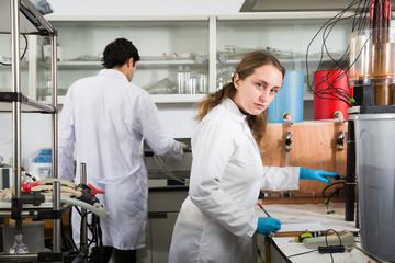 Female scientist using lab equipment