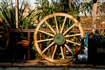Old traditional wagon wheel made of wood