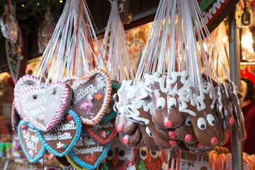 """Gingerbread Hearts at German Christmas Market. Inscriptions in German """"we wish you happiness"""" and """"always good"""""""