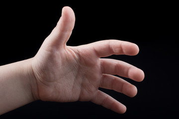 Five  fingers of a human hand partly seen in view