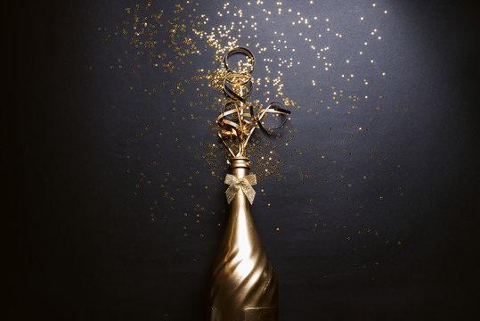 golden champagne on black background