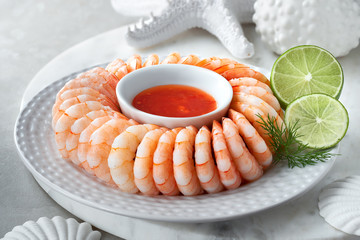 Close-up on shrimp ring with sweet chili sause with dill and lime