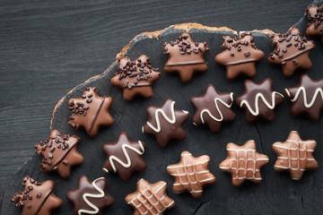 Star-shaped chocolates on dark textured background