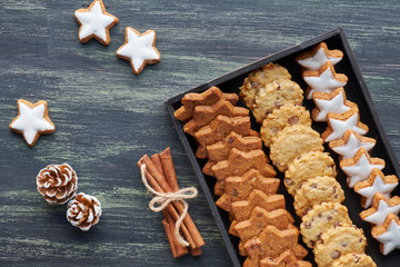 Christmas chocolate chip cookies, flat lay with spices and winter decorations on dark