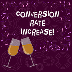 Writing note showing Conversion Rate Increase. Business photo showcasing Percentage of users who take a desired action Filled Wine Glass for Celebration with Scattered Confetti photo