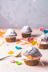 Tasty delicious homemade muffin on light pink living coral stone concrete surface