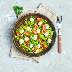 Fresh Cherry Tomato, Mozzarella salad with green lettuce mix