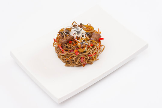 High angle view of spaghetti served in plate on white background