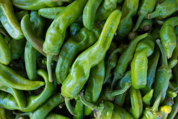 High angle view of green chili peppers for sale at market