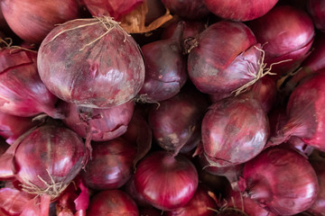 High angle view of onions for sale at market stall