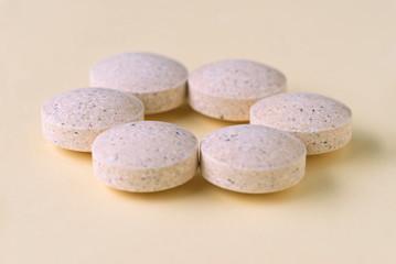 Close-up of medicines arranged on beige background