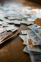 Close-up of postage stamps with tweezers on table at home