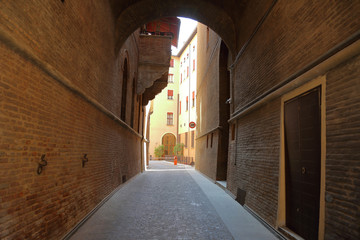 Diminishing perspective of alley amidst buildings in Bologna city