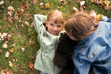 Two girls playing with dog