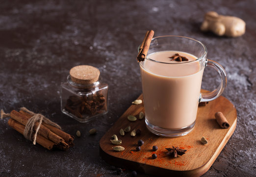 Masala chai tea on the dark background. Hot indian beverage with spices