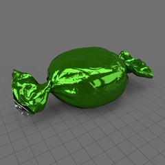 Hard candy in green wrapper
