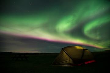 Aurora Borealis Northern Lights Iceland and illuminated tent