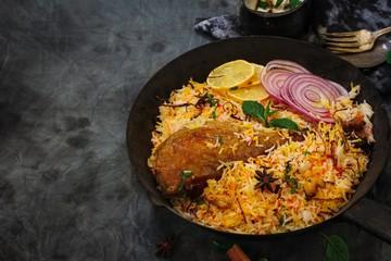 Turkey ( chicken ) Biryani / Thanksgiving meal on dark moody background