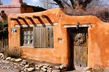 Santa Fe home in old adobe styled design and architecture.