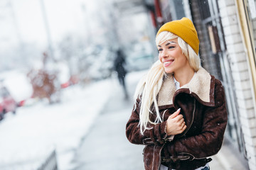 Blonde young woman in wintertime outdoor