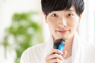 portrait of young asian man skin care image