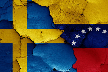 flags of Sweden and Venezuela painted on cracked wall