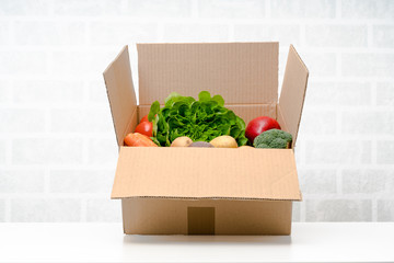 Fresh fruits and vegetables . Vegetables box, delivery box.