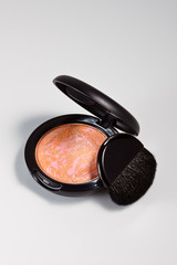 Pink and beige blusher or eyeshadow.