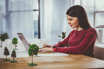 Positive joyful woman typing
