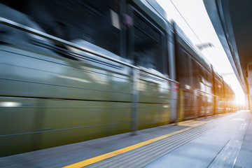 Subway station with train running in blurred motion