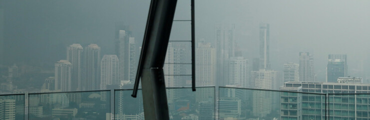 The skyline is seen through air pollution during a poor air quality day in Bangkok