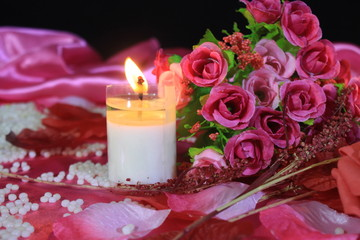 Roses bouquet and candle burning photoshoot. Valentine day