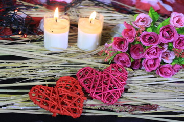 Photoshoot of lamp, two candle burning, flower and decoration Valentine