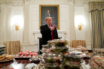 U.S. President Donald Trump speaks in front of fast food provided for the 2018 College Football Playoff National Champion Clemson Tigers due to the partial government shutdown in the State Dining Room of the White House in Washington