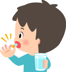 カプセル薬を飲む若い男性