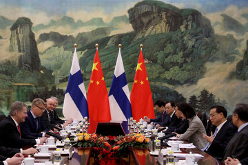Finnish President Sauli Niinisto and Chinese Premier Li Keqiang attend talks in Beijing, China, Tuesday