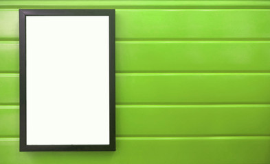 beautiful notification borad hanging on the colorful metal wall, black frame placing on bright green wall, square black pan on colorful green background