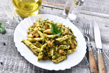 Penne pasta with spinach and meat