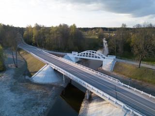 Pedistrian and auto bridge throught the river Vircava in Mezciems, Jelgava. Latvia.