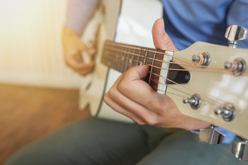 Man playing guitar , close up