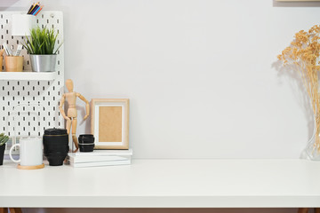 Minimalist stylish workspace poster, home office supplies and copy space