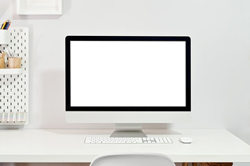 Mockup blank screen desktop computer on stylish workplace