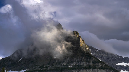 close up of storm clouds lifting from mount oberlin in glacier national park in montana, usa