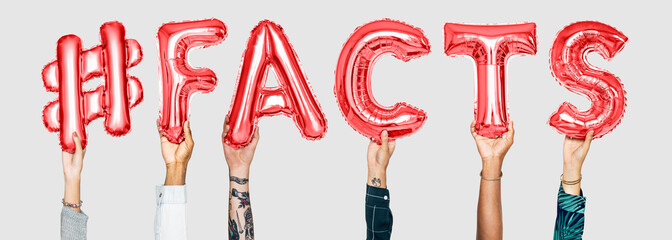 Hands holding #facts word in balloon letters