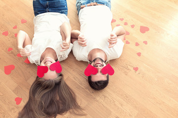 Funny couple covered eyes with red hearts. Valentines concept.