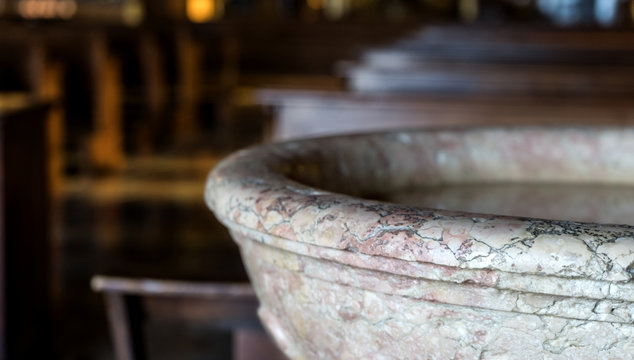old baptismal font in a church
