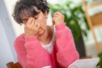 senior woman with eyes ache