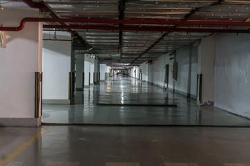 Empty Parking underground garage interior with blank billboard