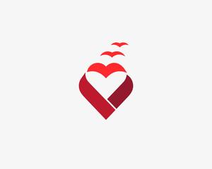 Heart ribbon bird vector logo. Valentines day vector logotype. Hope charity symbol
